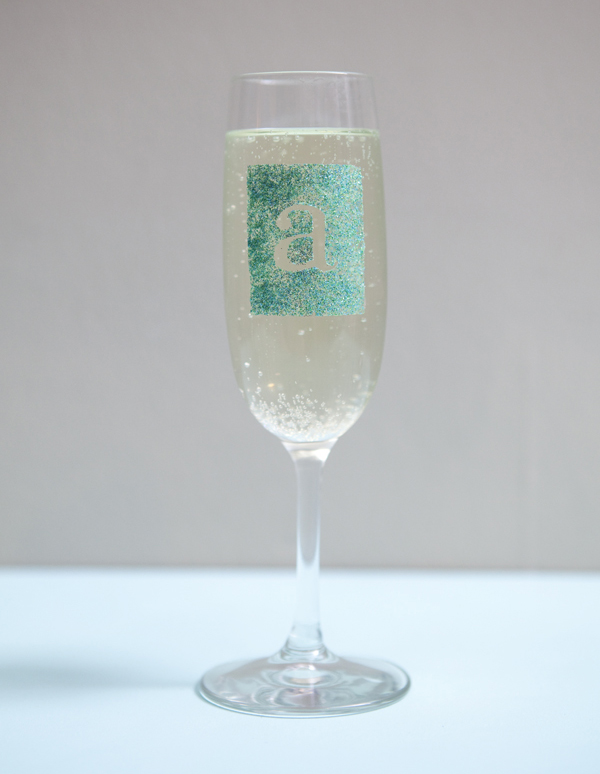 glam glitter champagne glass DIY by SomethingTurquoise.com